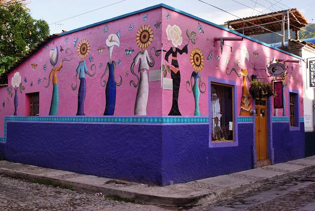 There is wall art, brightly painted buildings
